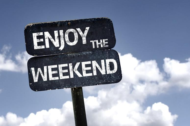 Enjoy the Weekend sign with clouds and sky background