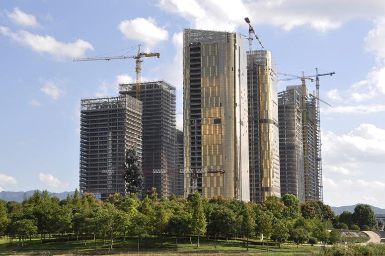 Construction phase of the complex high-rise buildings. China.