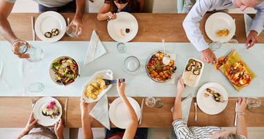 People sharing a meal around a dinner table
