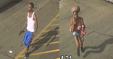 Surveillance video shows a woman talking on a cell phone and a man in blue shorts holding a gun out to his side at a BP gas station on Red Bridge Blvd on June 9
