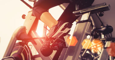 A person riding a stationary bicycle