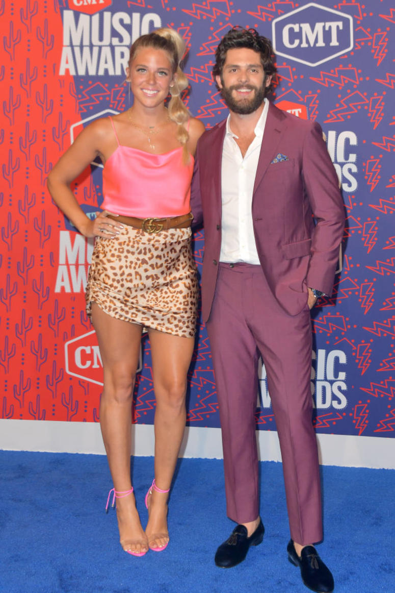 Lauren Akins and Thomas Rhett attend the 2019 CMT Music Awards - Arrivals at Bridgestone Arena on June 05, 2019 in Nashville, Tennessee