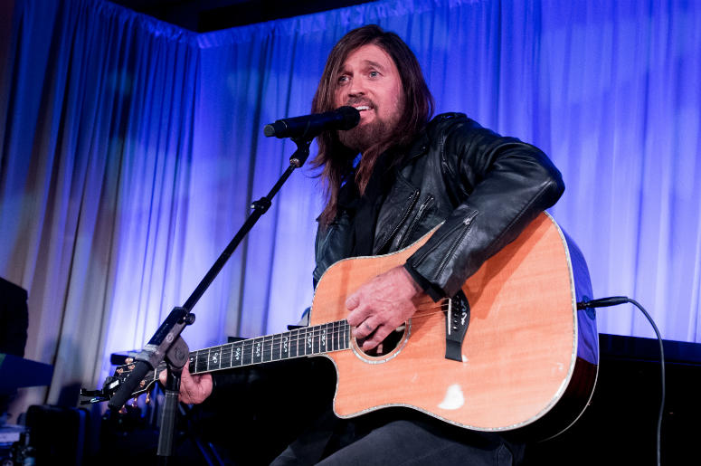 Billy Ray Cyrus performs onstage at the Celebrity Fight Night's Founders Club Dinner
