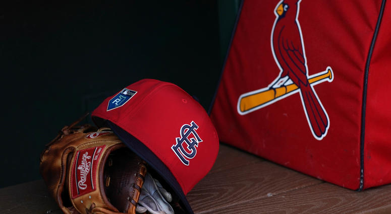 St. Louis Cardinals gear sits in the dugout.