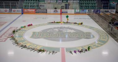 Flowers are shown at center ice as preparations are made at Elgar Petersen Arena for a vigil tonight in Humboldt, Saskatchewan, Sunday, April 8, 2018. Multiple people traveling with the Humboldt Broncos SJHL hockey team are dead, and many injured when the