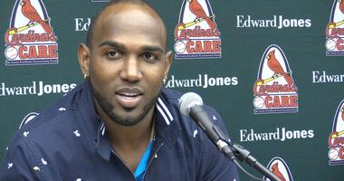 St. Louis Cardinals outfielder Marcell Ozuna talks to media