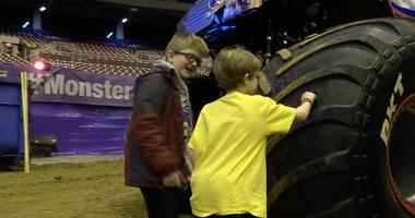 Kids from the Delta Gamma Center check out the trucks at Monster Jam.