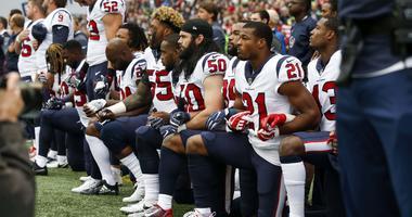 Houston Texans inside linebacker Benardrick McKinney (55), linebacker Ben Heeney (50), strong safety Marcus Gilchrist (21) and teammates kneel during the national anthem before