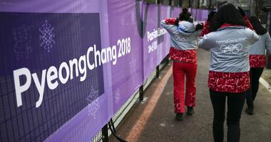 Feb 8, 2018; Gangneung, KOR; Volunteers walk outside of the Media Village in advance of the Pyeongchang 2018 Winter Olympic Games.