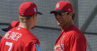 St. Louis Cardinals manager Mike Matheny (right) talks with Cardinals starting pitcher Luke Weaver
