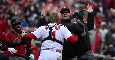 Catcher Yadier Molina yells at the Diamondbacks manager.