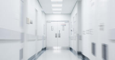 Empty corridor in modern hospital. Empty long hallway in the hospital. Empty clinic hall with white walls.