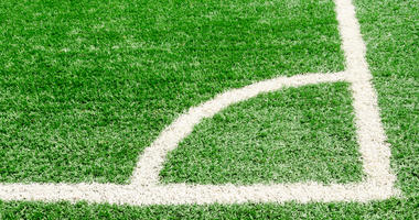 White corner field line on artificial green grass of soccer field,Artificial turf football field