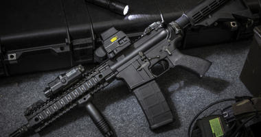 Assault rifle AR15 and flashlight