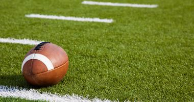 Football near the yardage line of a football field