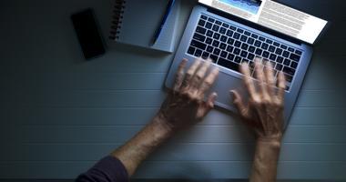 Man uses a laptop computer.
