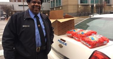 St Louis Police Officer Timothy Tripp, armed with candy, part of new effort to win back young children to police.
