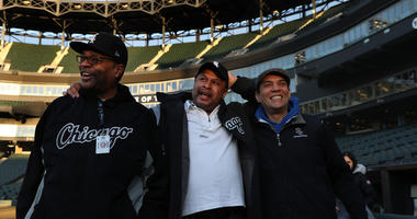 Nevest Coleman, center, enters Guaranteed Rate Field with friend and fellow grounds crew.