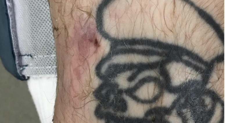 Tattoo found on right leg of man discovered on roadside July 5, 2019 in Madison County Illinois.