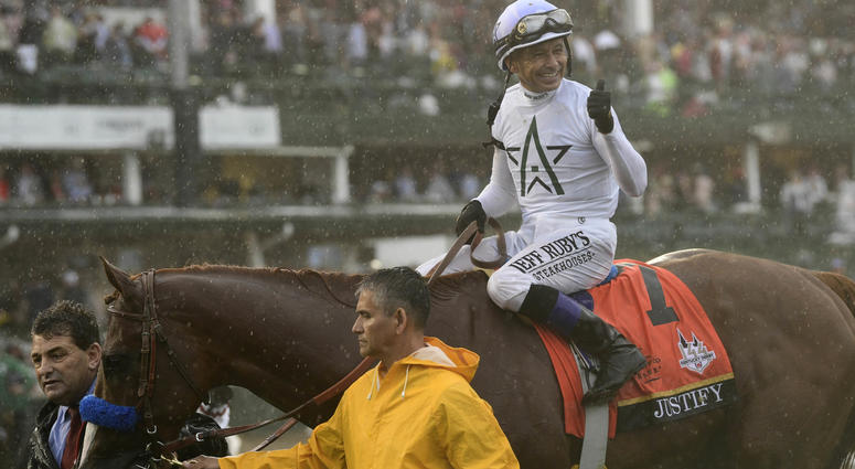 Mike Smith aboard Justify (7) celebrates after winning the 144th running of the Kentucky Derby