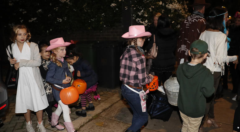 """Kids are playing """"Trick or Treat"""""""