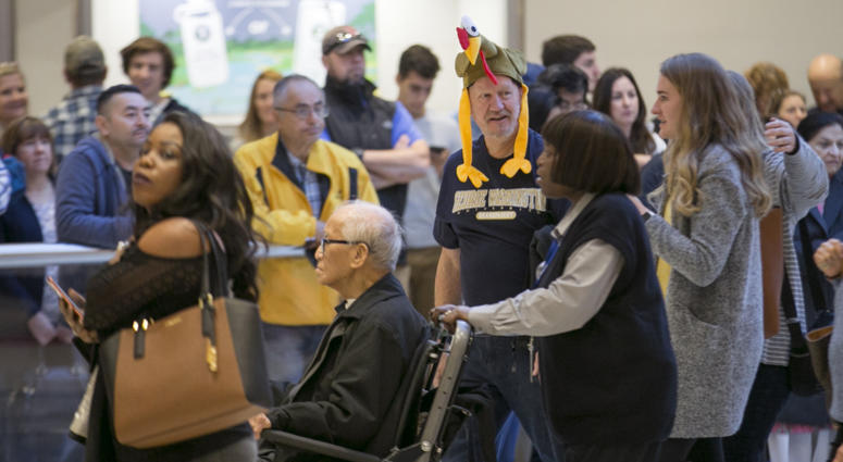 Arriving passengers head toward the baggage claim area at Hartsfield-Jackson Atlanta International airport on Wednesday, Nov. 22, 2017.