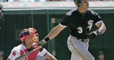 Chicago White Sox's Harold Baines (3) watches his ninth inning solo home run