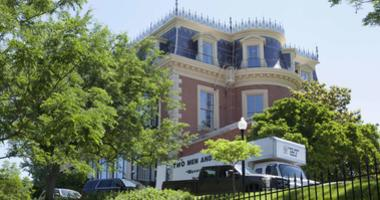 A moving van is seen parked outside the governor's mansion in Jefferson City, Mo., Friday, June 1, 2018.