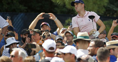 Justin Thomas watches his tee shot on the 15th hole during a practice round for the PGA Championship golf tournament at Bellerive Country Club, Wednesday, Aug. 8, 2018, in St. Louis.