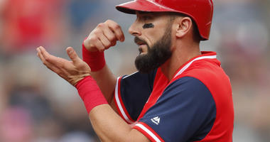 St. Louis Cardinals' Matt Carpenter gestures to the dugout