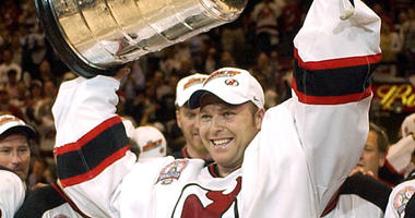 New Jersey Devils goalie Martin Brodeur celebrates with the Stanley Cup