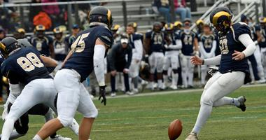 Shepherd University kicker Ruan Venter drop kicks and extra point during a college football game