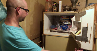 man finds frozen baby in freezer after death of mother