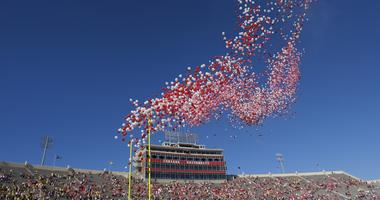 balloons are released in Memorial Stadium before an NCAA college football game