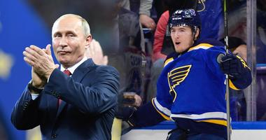 Russian President Vladimir Putin next to Blues forward Ivan Barbashev.