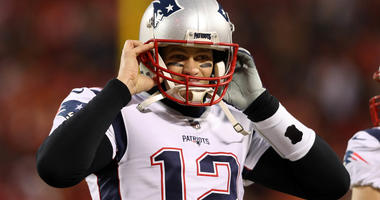 Tom Brady of the New England Patriots listens for a play call during the AFC Championship.