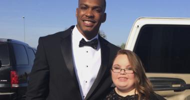 Lindsey Preston, next to NFL player Don Jones at Preston's prom in Moulton, Ala.