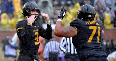 Missouri Tigers quarterback Drew Lock (3) celebrates
