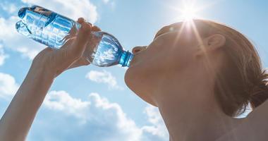 woman drinking water bottle