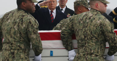 President Trump salutes the coffin of Scott Wirtz