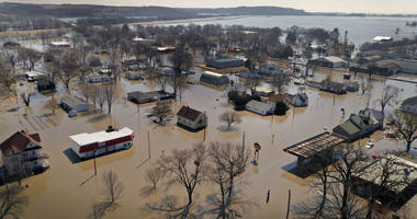 Homes and businesses are surrounded by floodwater on March 20, 2019 in Hamburg, Iowa.