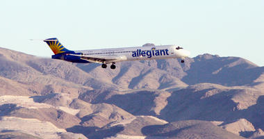 An Allegiant Air jet carrying members of the New Orleans Fire Department comes in for a landing at McCarran International Airport on September 6, 2005 in Las Vegas, Nevada.