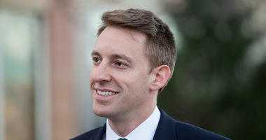Democratic candidate for U.S. Senate in Missouri Jason Kander speaks with members of the media on November 8, 2016 outside a polling place in Kansas City, Missouri.