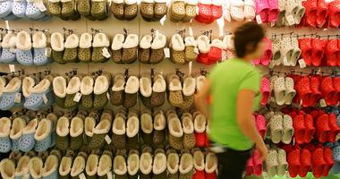 A shop assistant passes rows of hanging Crocs in the first UK Crocs store on October 18, 2007 in London England.