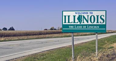 illinois welcome sign near corn field