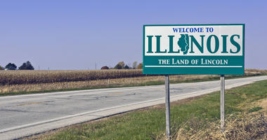 illinois welcome sign near corn field