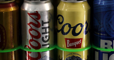 Cans of Coors beer are displayed on a shelf at a liquor store on May 2, 2018 in Fairfax, California.