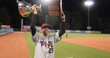 Manager Jason Bell of the Tri-City ValleyCats holds the New York Penn League Championship trophy.