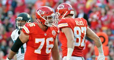 Kansas City Chiefs tight end Travis Kelce celebrates with offensive guard Laurent Duvernay-Tardif