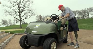 PGA Hope participant Bill Wiegand on the driving range at Bellerive Country Club.